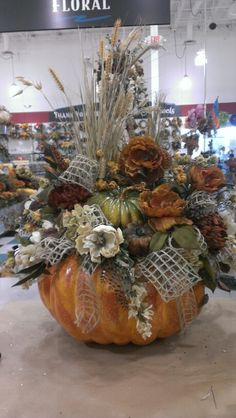 Thanksgiving flowers are a wonderful way to brighten up your dining room during your Thanksgiving holiday dinner. Pumpkin Arrangements, Fall Floral Arrangements, Pumpkin Centerpieces, Autumn Decorating, Pumpkin Decorating, Fall Flowers, Fall Pumpkins, Fall Crafts, Fall Table