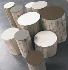 DIY Garden Stools ~ Take a cue from these Tupilak tree-stump stools by French company Bleu Nature; these have been topped with lacquered disks, but why not paint your own?