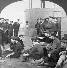 A portion of the crew of the Federal ironclad warship, the USS Monitor are photographed on the deck of the Civil War ship. The steam engine from the Monitor has been recovered July 16, 2001 off the North Carolina coast. The engine and other recovered artifacts from the Monitor will be preserved and put on display at the Mariner''s Museum in Newport News, Virginia.