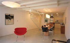 sótão reforma loft sala de estar escadas flutuante