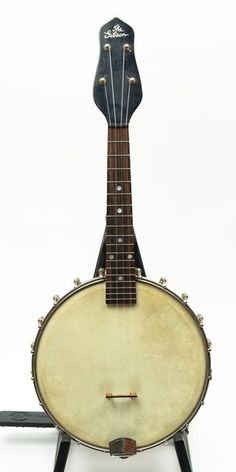 """Gibson UB trapdoor ukulele or melody banjo. 9"""" original skin head, fully functioning trapdoor resonator, 20 brackets, ebony fretboard with 18 frets with little wear, original small black friction tuners, tall heart shaped original Gibson bridge also present. Dot inlays on maple neck with """"THE GIBSON"""" script inlay on pegead overlay. Some wear around the peghead. Original canvas soft case included in sale, some stains and wear, some of the straps and latches have deteriorated."""
