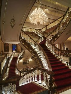 Gorgeous staircase and chandelier red carpet, long massive staircase, princess mansion