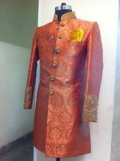 orange sherwani with yellow dhoti.. by sagar tenali.