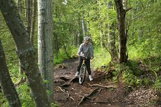 Mountain biking on a forest trail in Alaska.