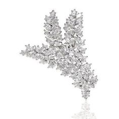 A Harry Winston brooch with 44 pear-shaped and marquise-shaped diamonds weighing a total of 21.94 carats, set in platinum.
