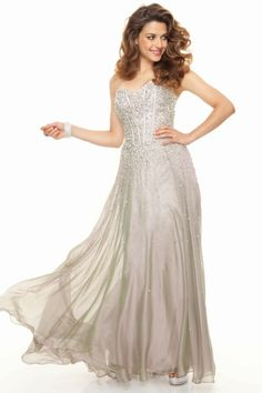 """Start out searching for your perfect long strapless silver prom dress by flipping through magazines and online to see what kind of dress you are most attracted to. Then hit the stores with an idea in mind of what you are looking for. Try on as many dresses as you can; your idea of the """"perfect dress"""" may not be as well suited for you as another style. Don't limit yourself."""