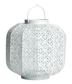 Large candle lantern in perforated metal with openable base. Handle at top. Size 8 3/4 x 8 3/4 in.