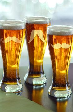 MUSTACHE PILSNER GLASSES. Handblown pilsner glasses that  feature four different mustaches for a little lighthearted fun :)