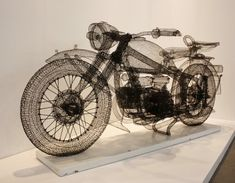The Chinese artist Shi Jindian creates three-dimensional sculptures of steel wire ... Paintings initially as packaging around cars, motorbikes, bicycles, and other familiar objects. When 3D mesh is completed, Shi Jindian carefully removes or destroys the object, leaving only its shadow metal.