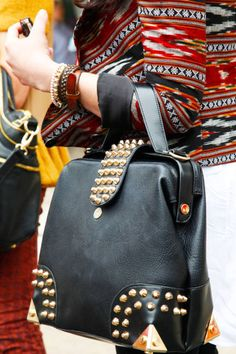 Cynthia Vincent    Black leather and stud detail create the ultimate tough-luxe handbag.    Bag: Topshop