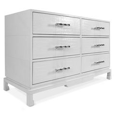 """Palm Beach meets Park Avenue in our Preston Six-Drawer Console. Chinoise lines inform the polished profile of this versatile console piece. Available in croc-embossed white leather with Ming feet and faux-bamboo handles. Perfect behind a sofa or underneath the Ellsworth Kelley in the hall.  • mock croc in stamped leather • 52"""" wide x 19"""" deep x 33"""" high"""