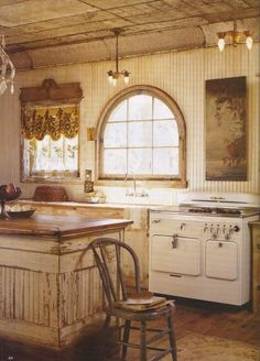 Rustic Kitchen. LOVE the old stove!!!