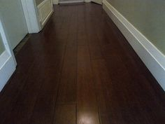 Bamboo hardwood flooring in the hall with white painted pine trim