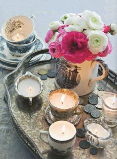 candles/flowers/pearls on old jewelry/mirror trays. those candles are in tea cups, too
