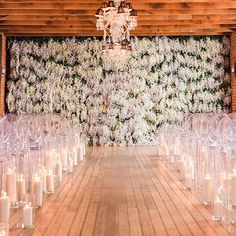 Say #IDo to a white #wisteria-covered floral backdrop! And with such a dramatic floral statement, we love the simplicity of the candle-lined aisle. Intimate and romantic ambience at its finest. Repost: @encore_eventdesign