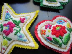 Handmade Vintage Stuffed Felt embroidered christmas ornaments cat star heart house from the vogue pattern 1754. $50.00, via Etsy.