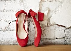 adorable red shoes with bows