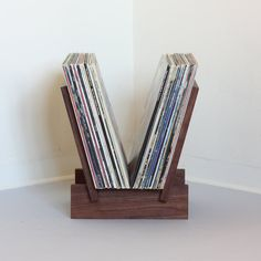 Solid walnut LP record stand in 4 parts. Sides fit into notches on base to create a solid stable platform for viewing and displaying albums. Displays
