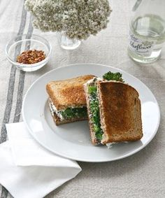 Green Mean Sammy  Ingredients 2 tbsp extra-virgin olive oil 1 bunch broccolini (about 12 stalks) 1 to 2 cloves garlic, smashed ¼ tsp crushed red pepper flakes 2 cups baby spinach 1 cup fat-free ricotta 8 slices whole-grain bread, toasted Kosher salt and freshly ground pepper