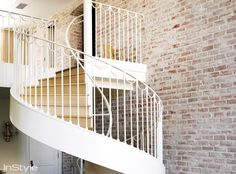 I would LOVE to have a spiral staircase like this! And the white washed brick veneer? Gorgeous.