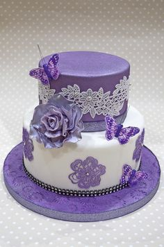 wedding cakes lace I bought some new cake lace mats recently and was dying to try them out so I though why wait until Ive got an order that I can use it on So I made up this display cake with it and used some beautiful feather butterflies on it as well. Purple Cakes, Purple Wedding Cakes, Cool Wedding Cakes, Wedding Cake Toppers, Gold Wedding, Gorgeous Cakes, Pretty Cakes, Cute Cakes, Amazing Cakes