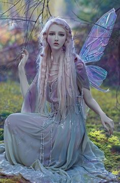 Such a stunningly magical image! She is in the old Titania fairy wings