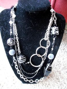 Another piece made from old broken jewelry parts. I used the round things from keychains for the big circles and mismatched beads for a little pop.