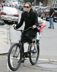 Angelina Jolie riding a bike.