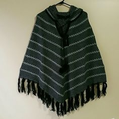 BCBG  PONCHOS. New never worn Beautiful ponchos  Color: Black /Grey/Gold Size X/XL Happy shopping BCBGMaxAzria Sweaters Shrugs & Ponchos