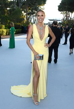 Formal Dress Inspiration | What All the Celebs Wore to the 2016 amfAR Gala | Heidi Klum wearing a low cut yellow dress with a high slit