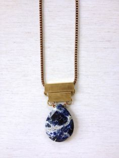 The secret to this outtasight pendant's outer-space vibe? The natural swirls within the sodalite stone. #etsy