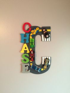 Made this letter C from a big wooden letter and small ones. Used acrylic paint and a pack of hot wheels cars and some gorilla glue. Looks great in my grandson's hot wheels themed bedroom!