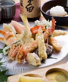 Tempura a Japanese dish of seafood or vegetables that have been battered and deep fried.