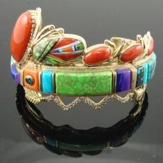 Cuff   Jesse Monongya (Navajo, Hopi). 18k gold, with Carico Lake, Old Kingman, Bisbee, Lone Mountain, Indian Mountain, Morenci, and Lander Blue Turquoise plus Gaspeite, Coral, Lapis, Sugilite, opal and diamonds. by hester