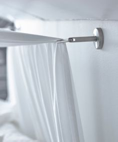 A close-up image of a curtain wire used to hang a canopy over a bed.