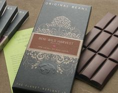 Original Beans Chocolate tapped Department of Graphic Sciences to develop a package that was as refined & environmentally-conscious as the chocolate brand itself.  Beyond the rich, floral design & raised globe icon, the packaging for Original Beans Chocolate was produced in an entirely wind-powered factory.  What's more, they plant a tree for every box of chocolate they sell.  The design preaches a refined sense of environmentalism & the company backs it up with sustainable business…