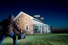 motion detector light in yard catching a potential burglar, homeowner survival skills