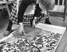 Marthe Armitage making her wallpaper prints...in a skirt.  Love.