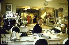 Christian Dior in his studio