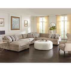 My dream sectional! I actually sat on this and could see the whole family snuggling up to a movie. Minus the leather chair, and the ottoman. Ick!