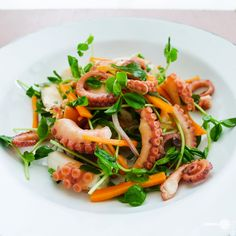 Octopus salad  http://wholesome-cook.com/2011/03/14/how-to-cook-octopus-tasty-salad-recipe/