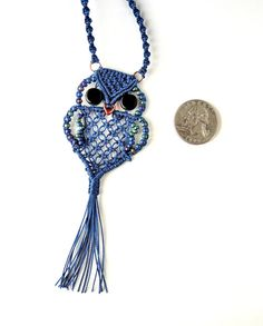 Nothing says retro 1970s kitch like a macrame owl and I love kitch! I knotted this cute little owl in my own pattern using navy blue cord and