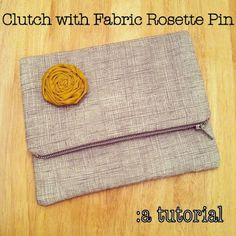 Tutorial on how to make your own clutch with fabric rosette pin!