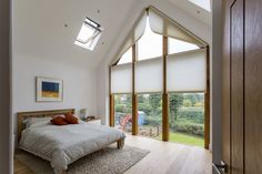This Leicestershire new-build has a double-height glazed gable with open countryside views. By night. Bedroom Curtains With Blinds, Bedroom Windows, Big Windows, Blinds For Windows, Window Blinds, Triangle Window, Gable Window, Electric Blinds, Attic Master Bedroom