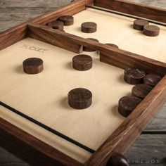"""Pucket -- """"Based on the traditional French game 'Table a L'elastique,' players race to clear the wooden pucks from their end of the board and the winner is the first to clear their side"""""""