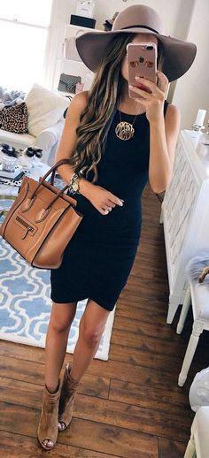 Black scoop-neck sleeveless dress.