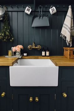 I love the contrast between the white sink and the dark cabinets and back splash. I love the contrast between the white sink and the dark cabinets and back splash. Fixer Upper House, Black Kitchens, Cool Kitchens, Kitchen Black, Boot Room Utility, Utility Sink, Ikea Utility Room, Utility Room Ideas, Home Interior