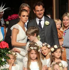 Princesses for the day: Chief bridesmaid Cara looks on with the little girls in the wedding party who looked pretty in white dresses with flowers in their hair