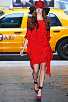 Red against yellow taxi