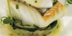 Cod fillet is coupled deliciously with crushed Jersey Royals and chive butter sauce in this cod recipe. Poached eggs add wonderful colour to this cod dish.